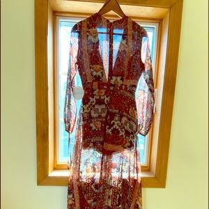 NWT Kiss the Sky Romper with sheer overlay